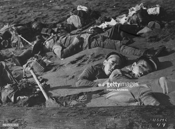 The early morning sun reveals the corpses of Japanese soldiers halfburied in the tidal sands of the Tenaru River after a futile attempt to dislodge...