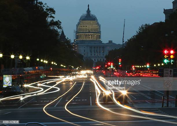 The early morning sun rises behind the US Capitol building as traffic drives down Pennsylvania Ave November 5 2014 in Washington DC Yesterday...