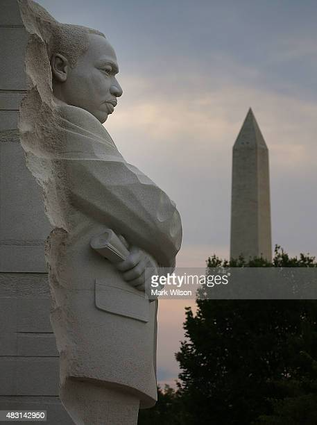 The early morning sun rises behind the Washington Monument and the Dr Martin Luther King Jr Memorial on the 50th anniversary of the Voting Rights Act...