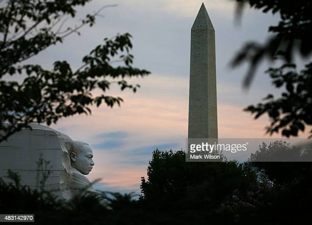 The early morning sun rises behind the Washington Monument and the Dr. Martin Luther King Jr. Memorial on the 50th anniversary of the Voting Rights...