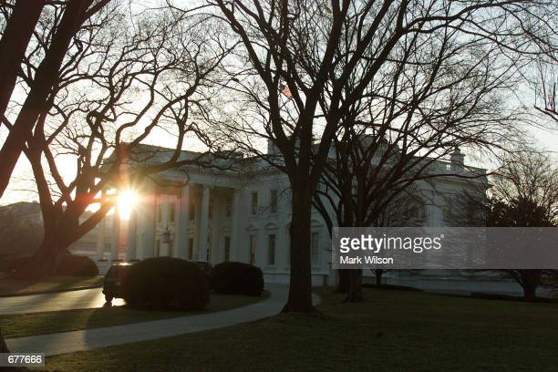 The early morning sun rises behind the White House before shots were fired near the south lawn February 7, 2001 in Washington, DC. Secret Service...