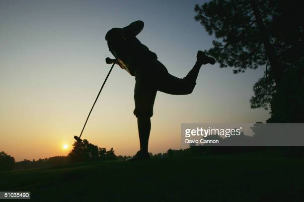 The early morning sun rises on the statue of the late Payne Stewart of the USA in his triumphant pose as he sunk the winning putt to become the 1999...