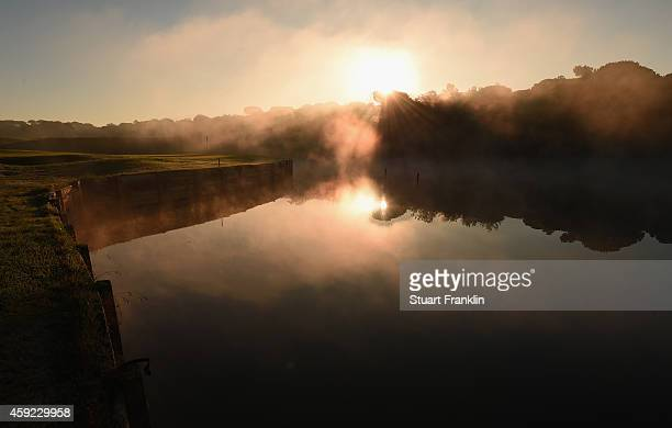 The early morning sunrises over the 11th hole prior to the fifth round of the European Tour qualifying school final stage at PGA Catalunya Resort on...