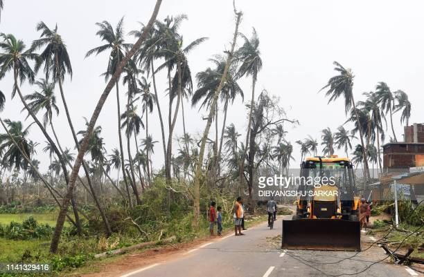 The earth moovers vehicle clear the road in Puri on May 05 2019 Cyclone Fani one of the biggest to hit India in years tore into Odisha on May 3...