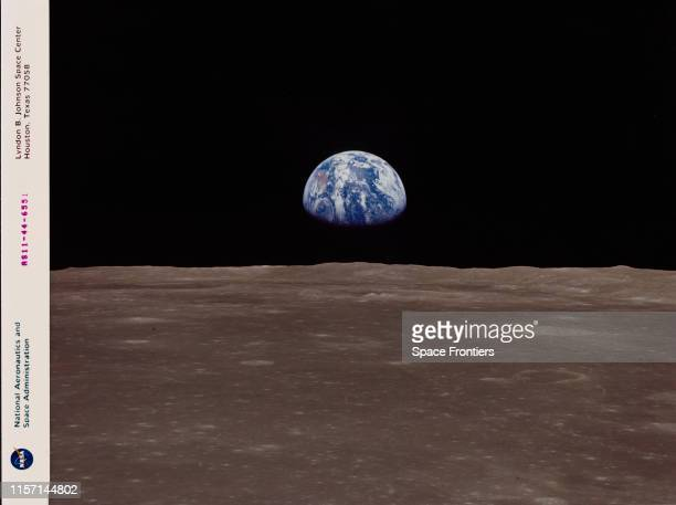 The Earth rises over the horizon of the Moon as seen during the Apollo 11 lunar landing mission July 1969 The centre of the image is located at 85...