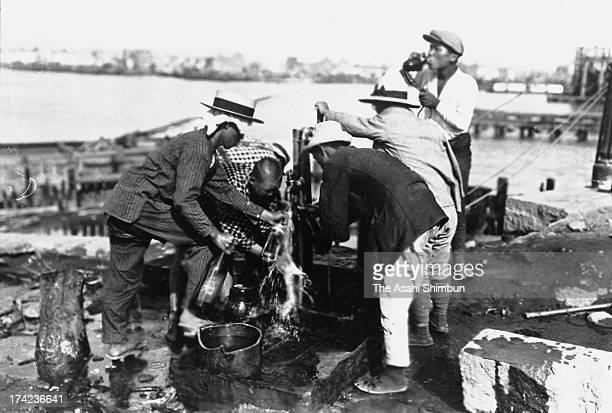 The earthquake survivors fill bottles with water near Eitaibashi Bridge in September 1923 in Tokyo, Japan. The estimated Magnitude 7.9 strong...