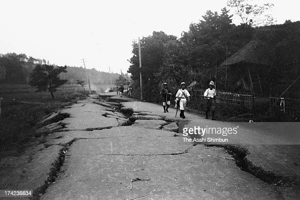 The earthquake survivors walk a damaged road in September 1923 in Totsuka Kanagawa Japan The estimated Magnitude 79 strong earthquake hit Japan's...