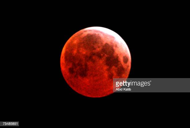 The earth's shadow passes over the moon for the first total lunar eclipse in three years March 3 2007 over Gaza City Gaza Strip The next full lunar...