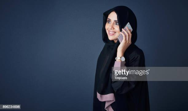 the easiest way to get good news - muslim woman darkness stock photos and pictures