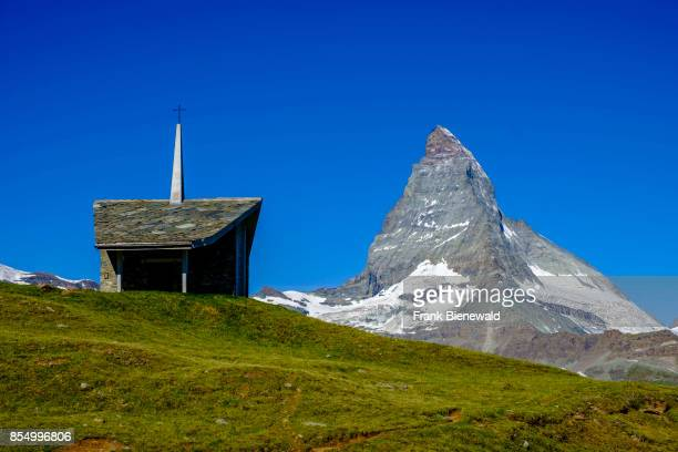 ZERMATT VALAIS SWITZERLAND The East and North Face of the Matterhorn Monte Cervino behind the small Chapel Bruder Klaus