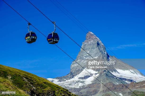 ZERMATT VALAIS SWITZERLAND The East and North Face of the Matterhorn Monte Cervino behind the mast of the cablecar to Riffelberg