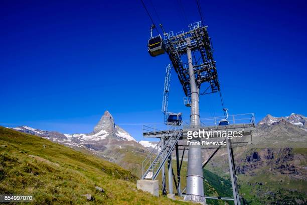 ZERMATT VALAIS SWITZERLAND The East and North Face of the Matterhorn Monte Cervino behind two gondolas of the ropeway to Riffelberg