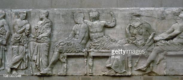The East frieze of the Parthenon, Acropolis of Athens, Greece. Sacrificial procession. Gods and Godesses. The Peplos Scene. Pentelic marble. Stone...