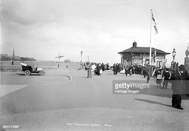 The east promenade Lytham St Anne's Lancashire 18901910 An early car stands to the left of the photograph with a number of pedestrians to the right...