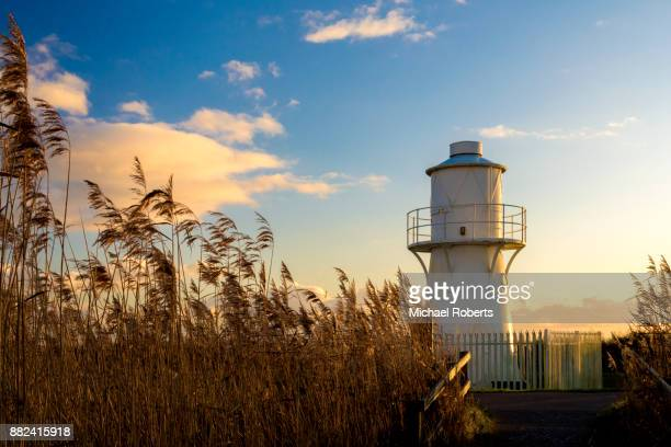 the east usk lighthouse on the newport wetlands nature reserve in south wales - newport south wales stock pictures, royalty-free photos & images