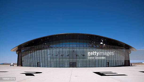 """The east windows of the main hanger at Spaceport America reflect the logo for the latest Will Smith movie, """"After Earth"""". Spaceport America was the..."""