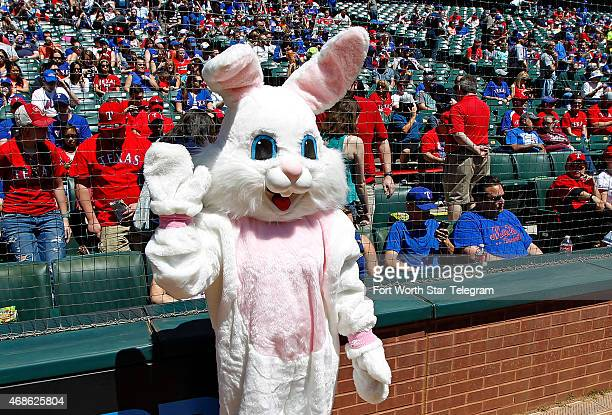 The Easter Bunny makes an appearance behind home plate as the New York Mets visit the Texas Rangers during exhibition action at Globe Life Park in...