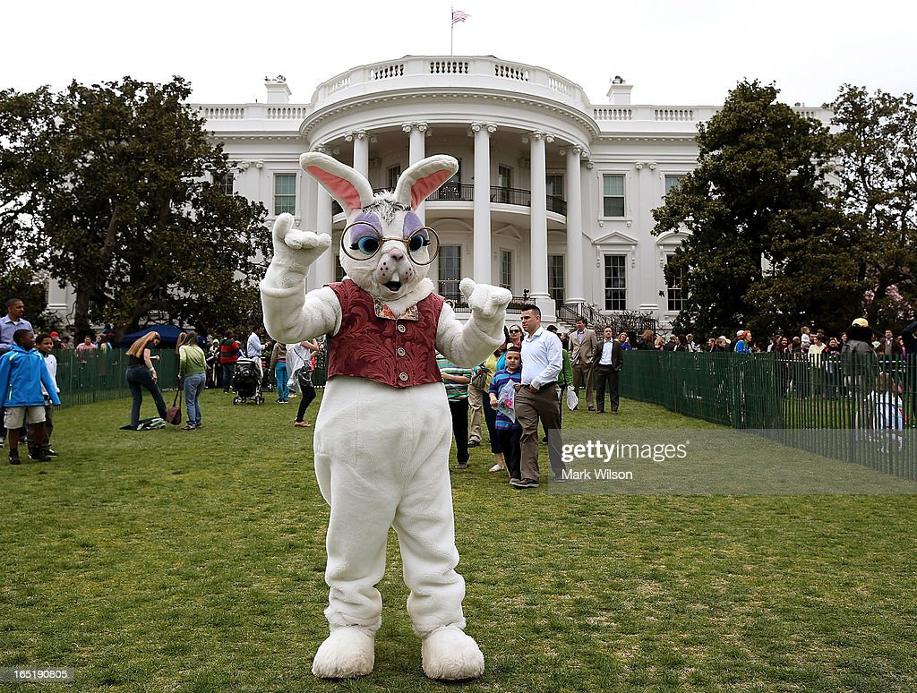 The Easter Bunny participates in the annual Easter Egg Roll at the White House April 1, 2013 in Washington, DC. Thousands of people are expected to attend the 134-year-old tradition of rolling colored eggs down the White House lawn that was started by President Rutherford B. Hayes in 1878.