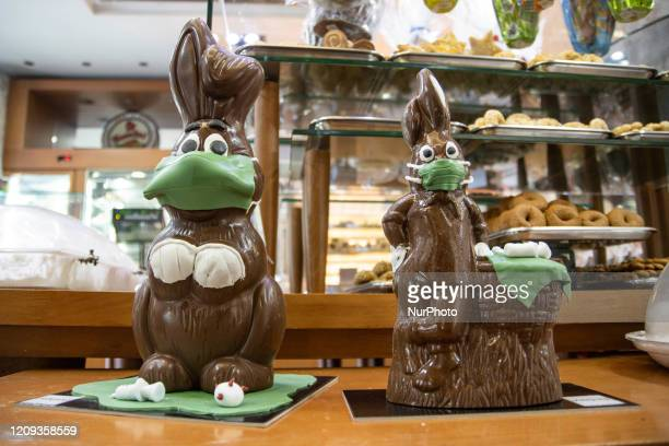 The Easter chocolate bunny the ''Coronavirus doctor bunnies'' with face masks vaccines and representation of the Covid19 pandemic molecule created by...