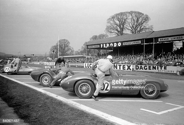 The Easter Meeting Goodwood April 7 1958 Stirling Moss was the best of his era at the Le Mans type start and here he wins it again leaping into his...