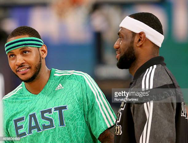 The Eastern Conference's Carmelo Anthony of the New York Knicks and LeBron James of the Miami Heat warm up before the game against the Western...