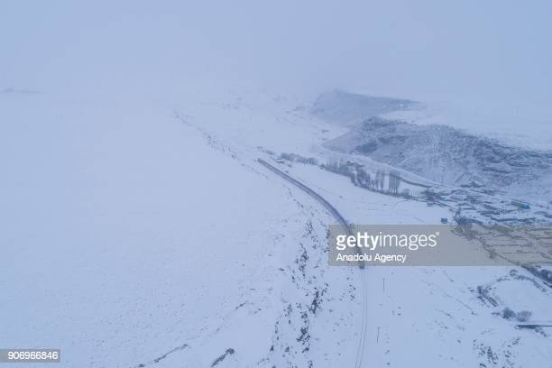 The Eastern Express which travels from Ankara to Kars passes near a slope in Kars Turkey on January 13 2018 With the starting of winter season...