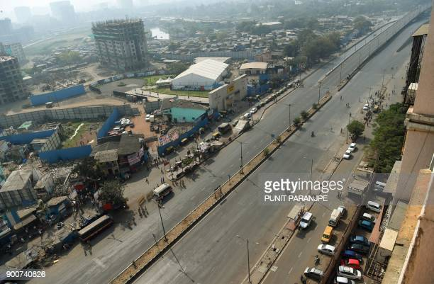 The Eastern expressway is seen deserted after Republican Party of India supporters blocked the road during a protest in Mumbai on January 3 2018...