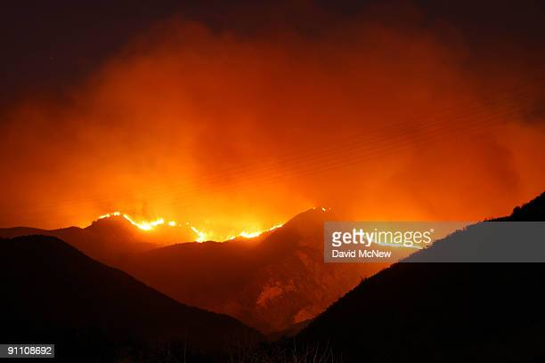 The eastern flank of the 16000plusacre Guiberson fire burning out of control for a second day as Red Flag warnings continue in southern California...