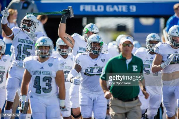 The Eastern Michigan Eagles enter the field before a regular season college football game between the Eastern Michigan Eagles and the Kentucky...