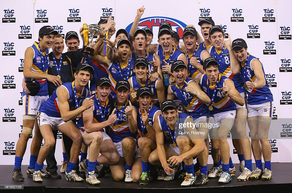 The Eastern Ranges celebrate with the Premiership Cup after winning the TAC Cup final match between Eastern Ranges and the Dandenong Southern Stingrays at Etihad Stadium on September 22, 2013 in Melbourne, Australia.