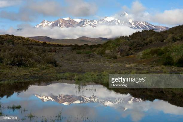 The eastern slopes of Mount Ruapehu in Tongariro National Park are reflected in a pool of water in Tangiwai New Zealand on Tuesday Jan 15 2007 A...