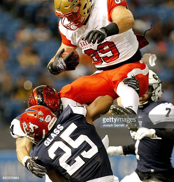The East's Antony Auclair of Laval is caught in the air by West's Tyquwan Glass of Fresno State during the third quarter of the EastWest Shrine Game...