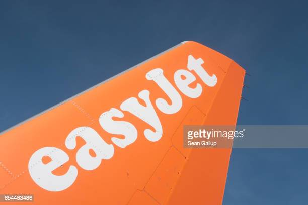 The easyJet logo is seen on the rudder of an easyJet passenger plane at Schoenefeld Airport near Berlin on March 4 2017 in Schoenefled Germany...