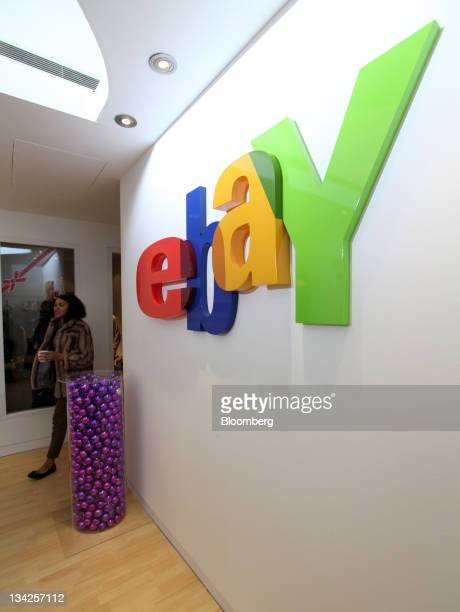 The EBay Inc company logo hangs inside the company's Christmas 'popup' store in London UK on Tuesday Nov 29 2011 Amazoncom Inc and EBay Inc aiming to...
