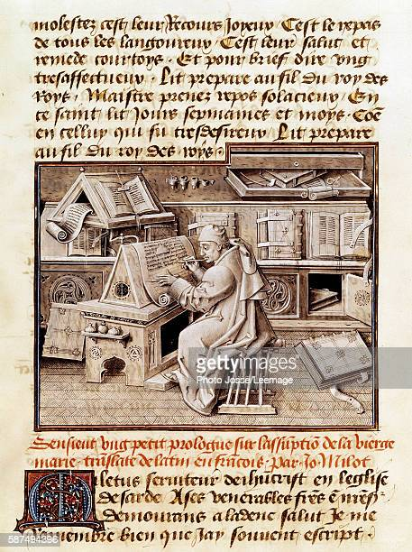 The ecclesiastical translator and copyist Jean Mielot depicted working in his office Page from a manuscript of the 15th century BN Paris France