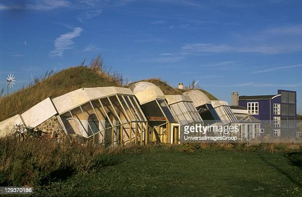 The ecohouses have a turf roof and are partially buried to conserve heat They reduce heat loss by about 30%