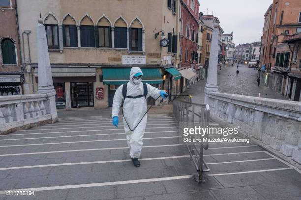 The ecological operator disinfects the Ponte delle Guglie on March 11 2020 in Venice Italy The Italian Government has taken the unprecedented measure...