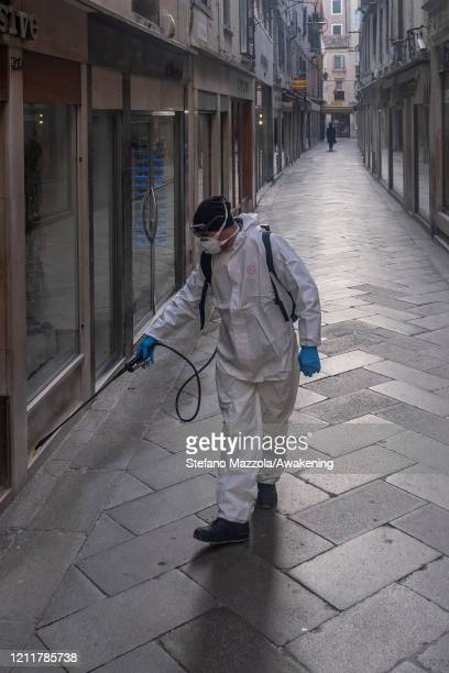 The ecological operator sanitizes a calle near Piazza San Marco on March 11 2020 in Venice Italy The Italian Government has taken the unprecedented...