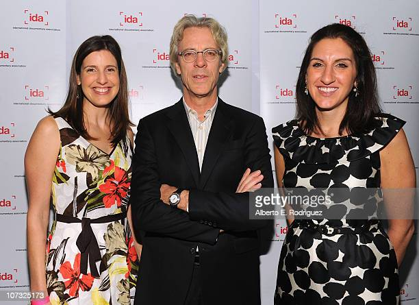 The Economist's Erin Aylor musician Stewart Copeland and The Economist's Dana De Simone arrive at the International Documentary Association's 26th...