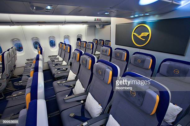 The economy class cabin of a Lufthansa Airbus A380 airplane is pictured in Frankfurt Germany on Wednesday May 19 2010 Deutsche Lufthansa AG said the...