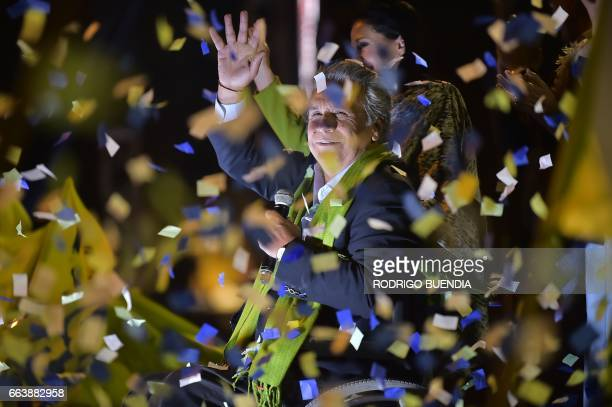TOPSHOT The Ecuadorean presidential candidate of the ruling Alianza PAIS party Lenin Moreno waves to his supporters as they wait for the final...