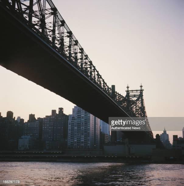 The Ed Koch Queensboro Bridge also known as the Queensboro Bridge or 59th Street Bridge over the East River in New York City circa 1960