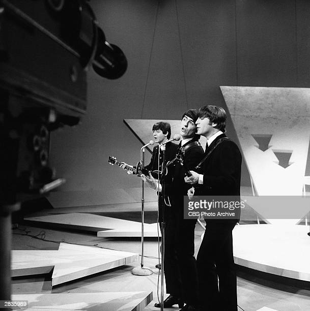 'The Ed Sullivan Show' featuring The Beatles performing on Sunday February 9 from CBS's Studio 50 in New York City 3 of the 4 band members Paul...