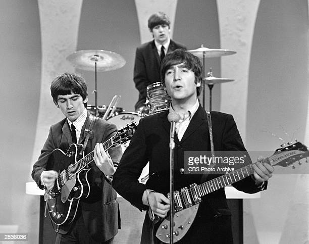 'The Ed Sullivan Show' featuring The Beatles, performing on Sunday, February 9 from CBS's Studio 50 in New York City. Three of the four band members...
