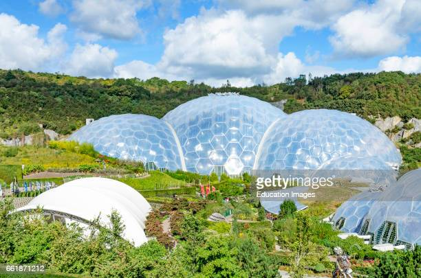 The Eden Project in Cornwall England UK is an educational visitor attraction two large glass biomes house tropical and Mediterranean plants for...