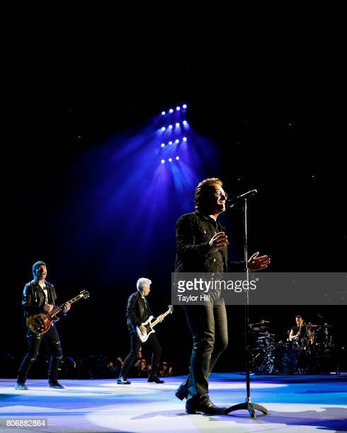 The Edge Adam Clayton Bono and Larry Mullen Jr of U2 perform during 'The Joshua Tree Tour 2017' at MetLife Stadium on June 29 2017 in East Rutherford...