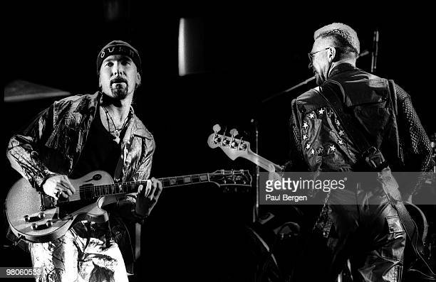 The Edge and Adam Clayton of U2 perform on stage on the Zooropa Tour at Kuip on May 10th 1993 in Rotterdam Netherlands The Edge plays a Gibson Les...
