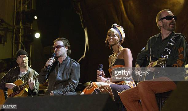 The Edge and Bono of U2 and Beyonce Knowles and Dave Stewart perform at The Nelson Mandela Foundation's '46664 Give One minute to Aids' Concert at...