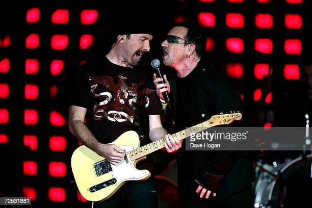 The Edge and Bono of U2 perform on stage at the first of three rescheduled Sydney dates on their Vertigo Tour at the Telstra Stadium on November 10...