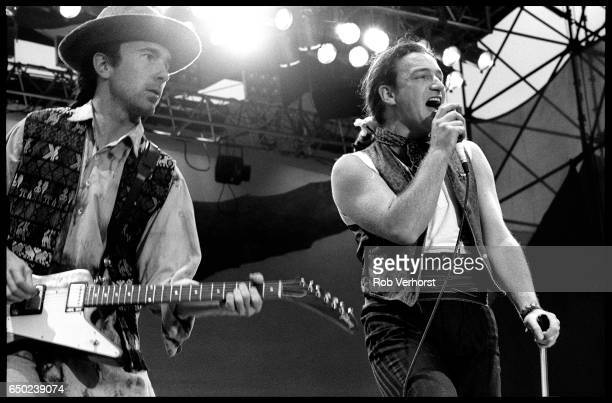 The Edge and Bono of U2 perform on stage on The Joshua Tree Tour at Feyenoord Stadion De Kuip Rotterdam Netherlands 10th July 1987 The Edge is...